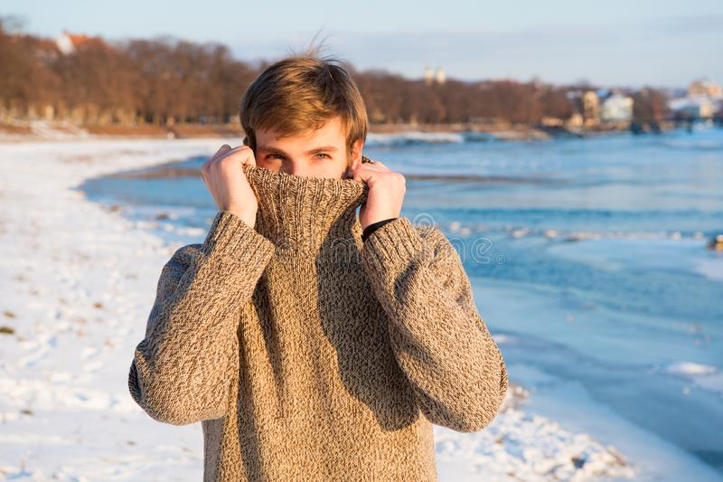 Warm clothes for cold season. Winter fashion. Warm sweater. Man traveling in winter, nature. man in warm clothes stock photo