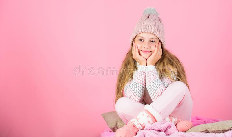 Warm clothes concept. Keep warm and comfortable. Warm accessories that will keep you cozy this winter. Kid girl wear royalty free stock image
