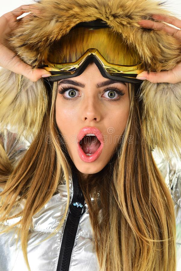 Warm clothes. Oh my god. Ski resort and snowboarding. Happy winter holidays. Girl in ski or snowboard wear. Winter sport. And activity. woman in winter clothes royalty free stock photo