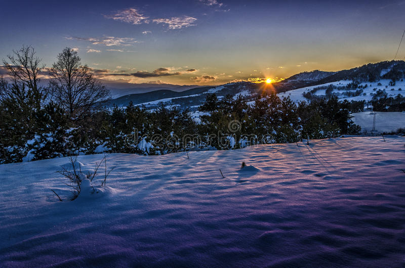 Warm cold winter sunset. Over mountein royalty free stock photo