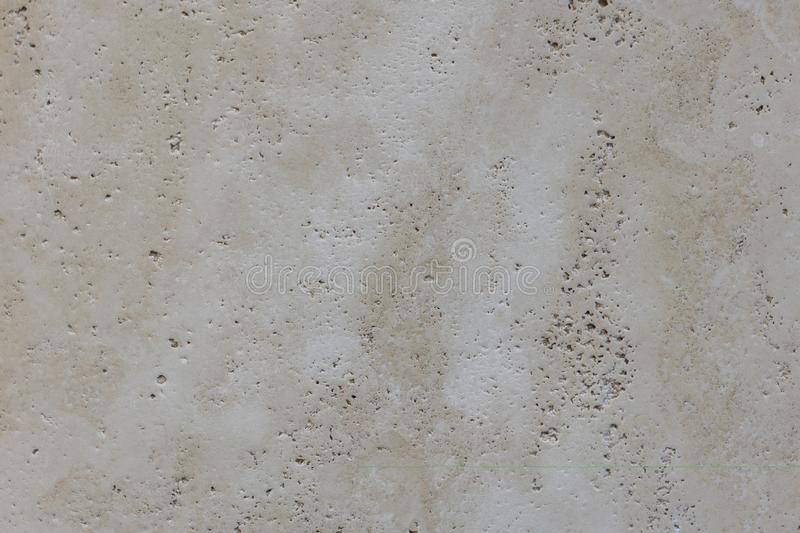 Warm concrete texture photo for background. Shabby chic backdrop. Natural stone surface with drips and dirt. Distressed texture in stock image