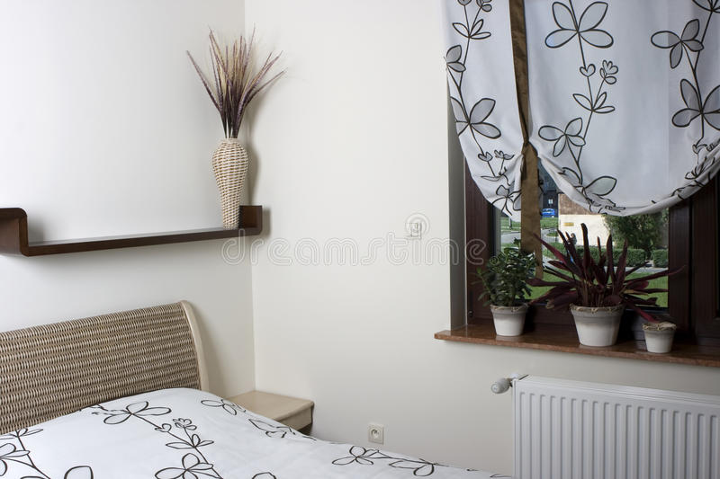 Warm, Contemporary Bedroom royalty free stock images