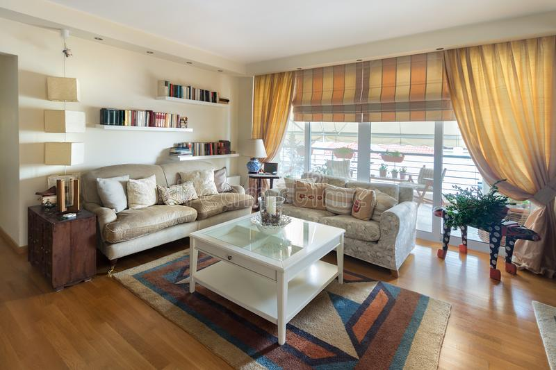 Warm contemporayy style living room with two sofas on an oak flo royalty free stock photography