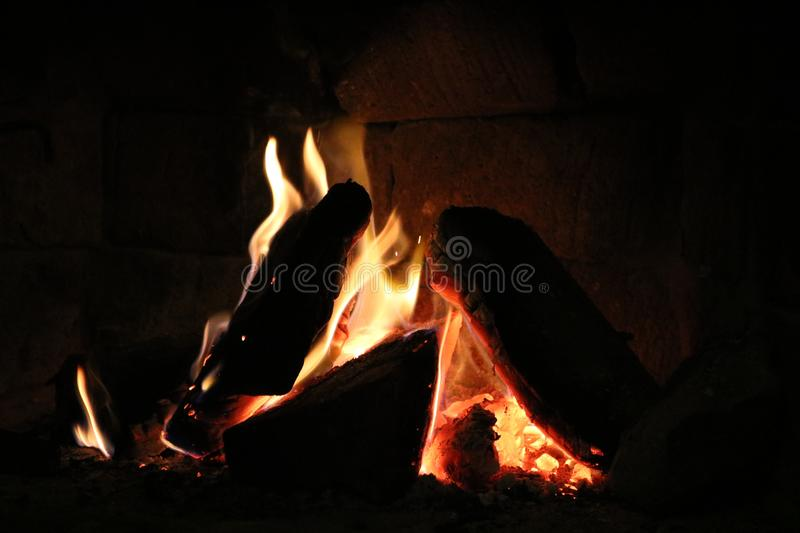 Wood burning in a cozy fireplace at home stock image