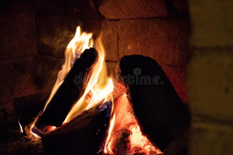Wood burning in a cozy fireplace at home royalty free stock image