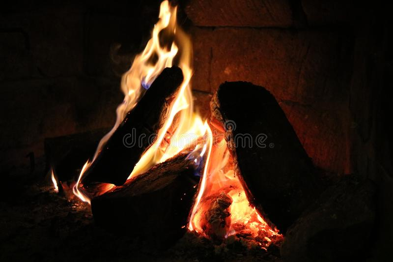 Wood burning in a cozy fireplace at home stock images
