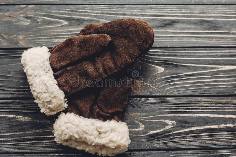 Warm cozy gloves on rustic background top view, space for text. stock photo