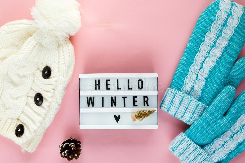 Warm, cozy winter scarf, lightbox on pastel and cup of coffee with marshmallow pink background. Christmas, New Year. Warm, cozy winter scarf, lightbox, mittens stock photos