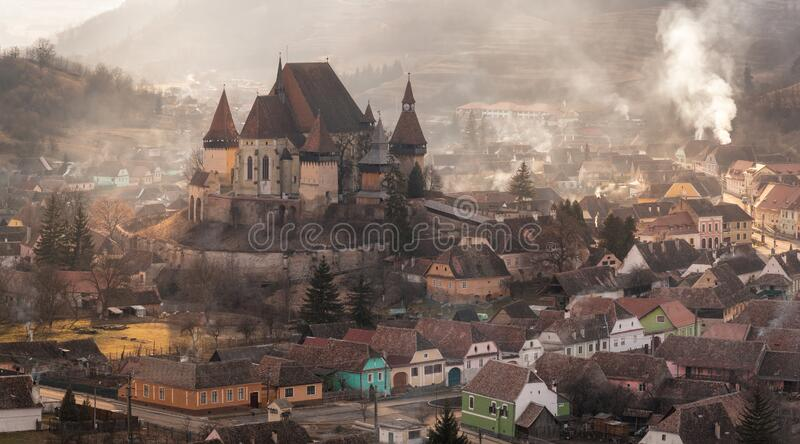 Warm February Evening In Biertan, One Of The Most Famous Four Ancient Fortification Churches Of Romania. Unesco-Protected Lutheran royalty free stock photos