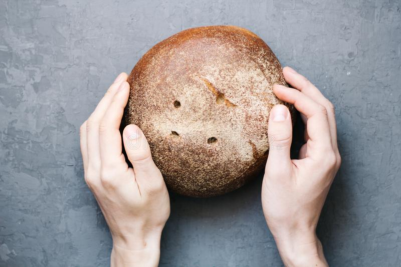 Warm, freshly rye bread. Cut the slices. Tear off a piece with your hands. top view. Farm food made from flour and eggs. royalty free stock photos