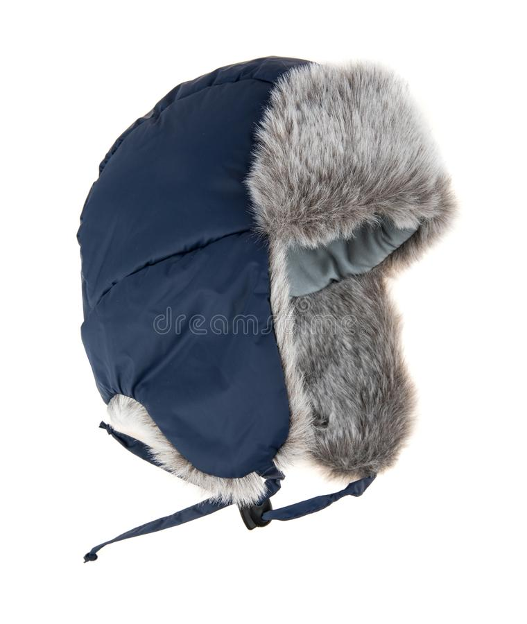 Warm fur cap. On a white background royalty free stock photography