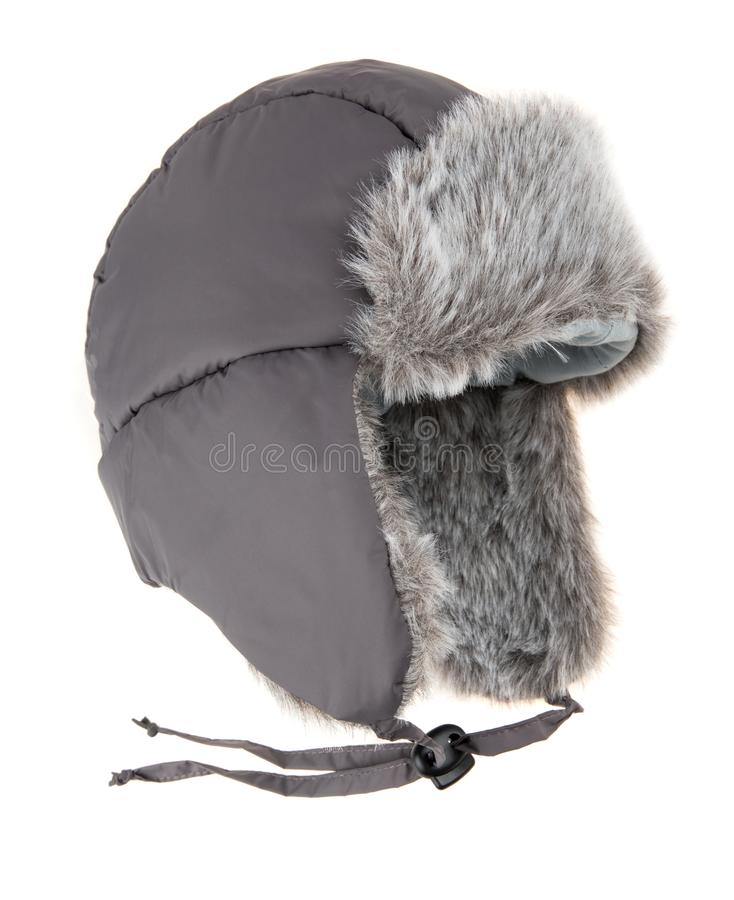 Warm fur cap. On a white background royalty free stock photo