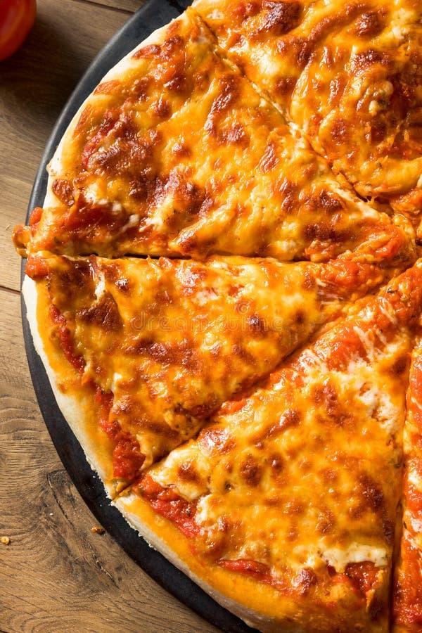 Warm Homemade Italian Cheese Pizza royalty free stock photography