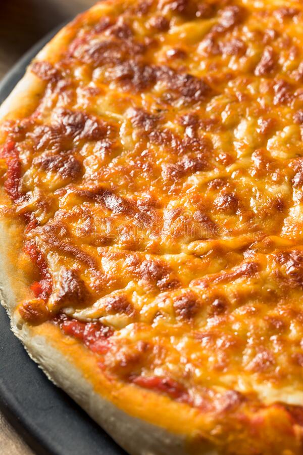Warm Homemade Italian Cheese Pizza royalty free stock images