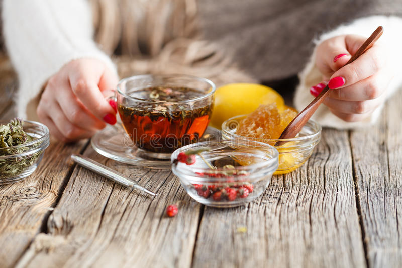 Warm honey tea with herbs. Healthcare concept royalty free stock photography