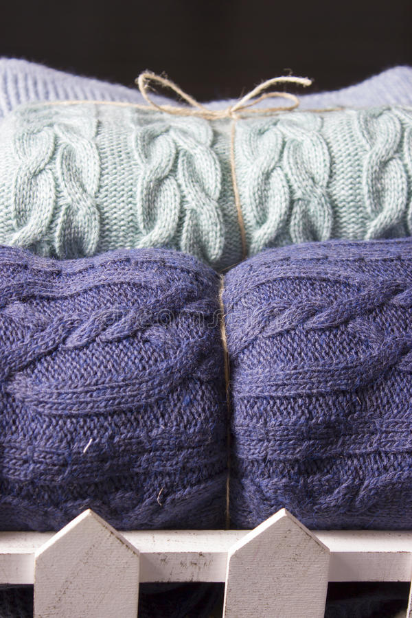 Warm knitted blankets folded stack. Comfort and convenience royalty free stock photo
