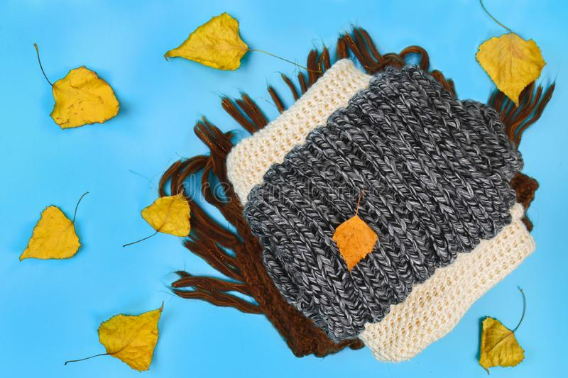 Warm knitted sweaters. Pile of knitted clothes on blue background, sweaters, knitwear, space for text, Autumn winter concept. Top. View stock photo