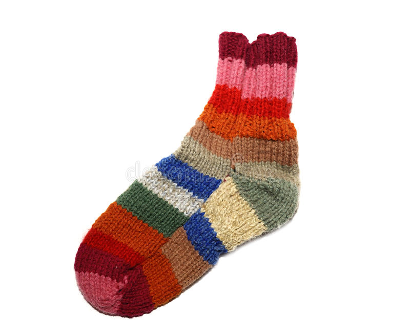 Warm knitted woolen sock knitting needles isolated on a white ba royalty free stock image