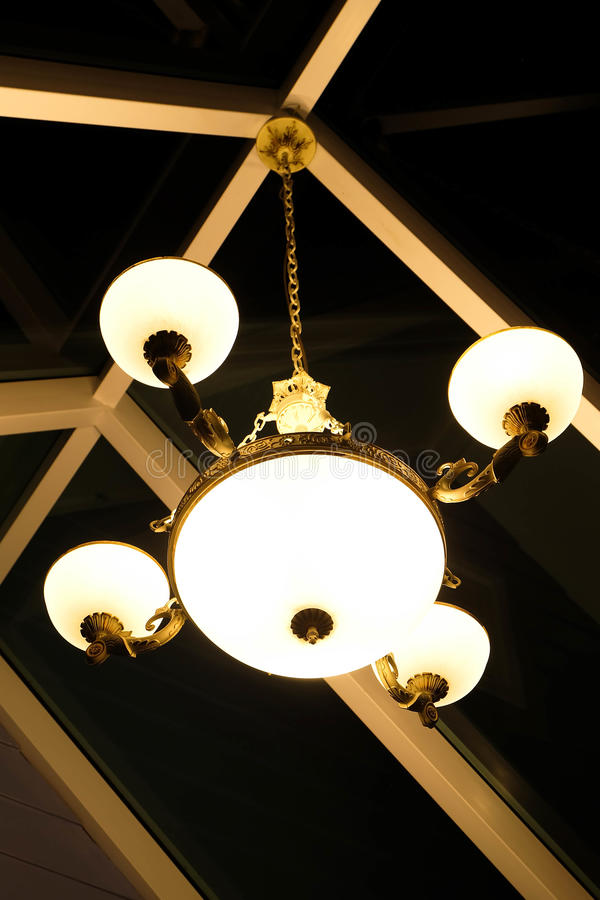 Warm lighting coming out from beautiful lamps on ceiling. Electric lamp in dark. Vintage lamp in a cafe. Abstract lamp on royalty free stock photography
