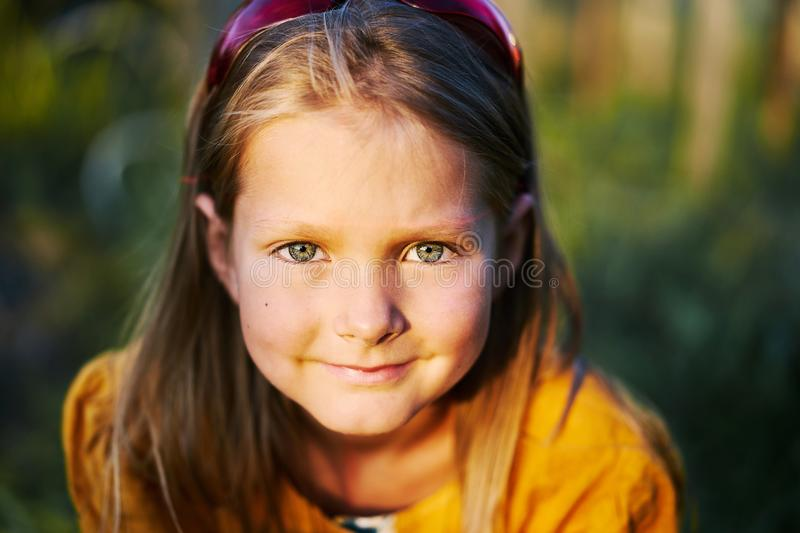 Warm little girl portrait person close clean eyes smile. Face autumn colors smiling kind frank stock photography