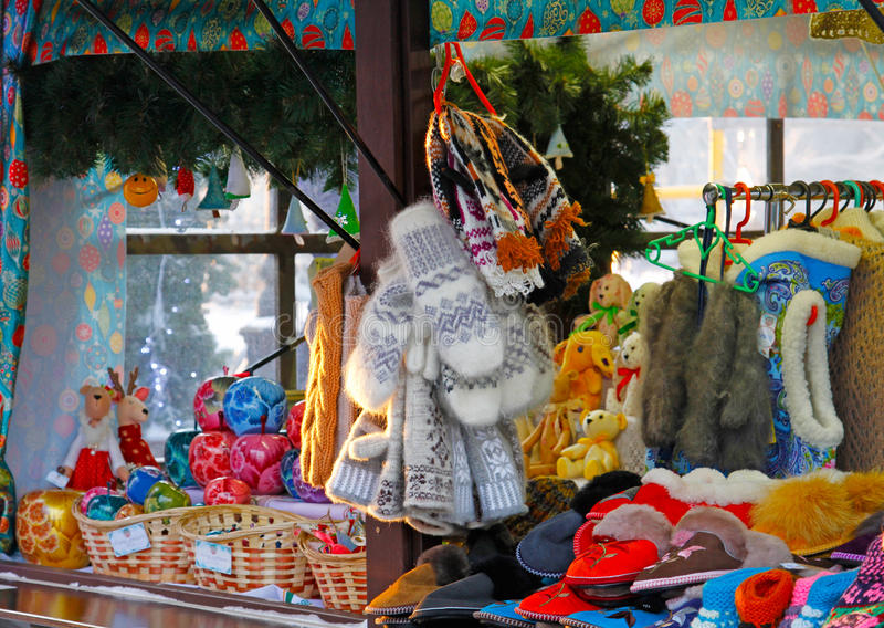 Warm mittens, slippers and christmas toys in one of the stalls stock photos