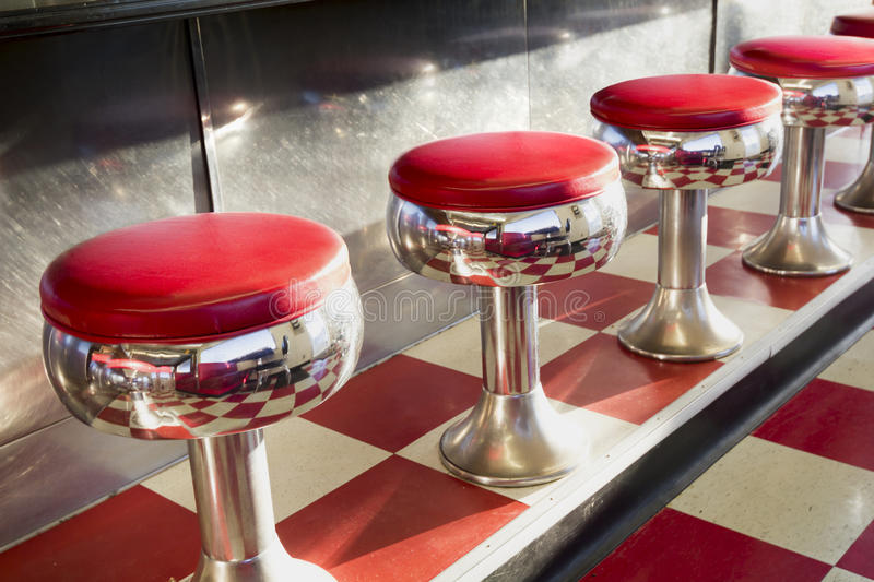 Warm Morning Sunlight Highlights These Beautifully Classic Diner Seats. Warm morning sunlight highlights the simple but beautiful design of this classic diner stock photo