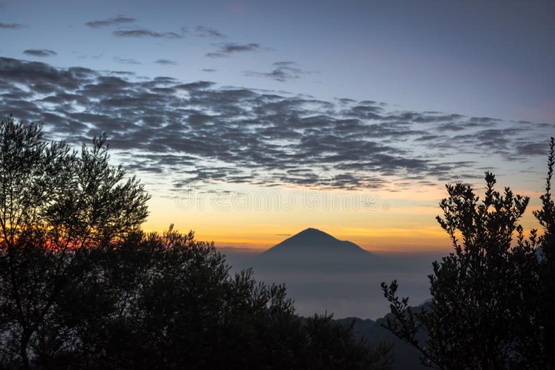 Warm morning sunrise on Ghober Hut campsite with view of mount Cikuray. Beautiful landscape of mount Papandayan. Papandayan. Mountain is one of the favorite stock photos