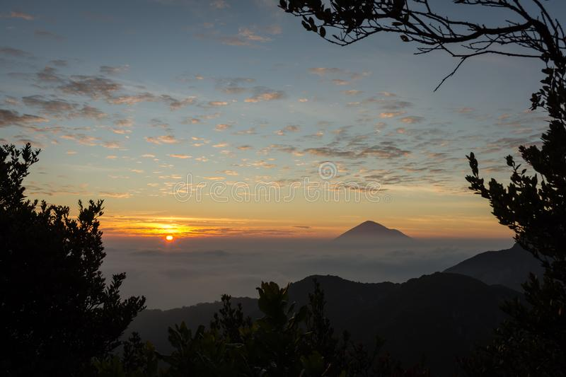 Warm morning sunrise on Ghober Hut campsite with view of mount Cikuray. Beautiful landscape of mount Papandayan. Papandayan. Mountain is one of the favorite royalty free stock image