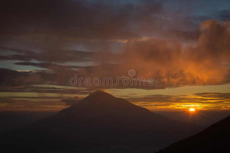 Warm morning sunrise on Tebing Soni with view of mount Cikuray. Beautiful landscape of mount Papandayan. Papandayan Mountain is. One of the favorite place to stock photos