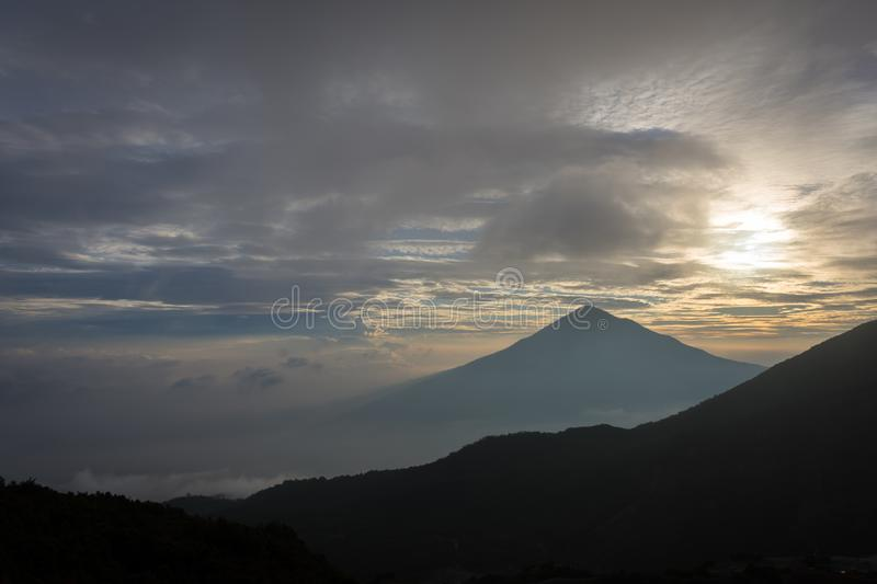 Warm morning sunrise on Tebing Soni with view of mount Cikuray. Beautiful landscape of mount Papandayan. Papandayan Mountain is. One of the favorite place to stock photo