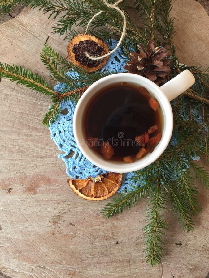 Warm mug of tea outdoors. Winter cosiness: warm mug of tea outdoors on a wooden background stock photos