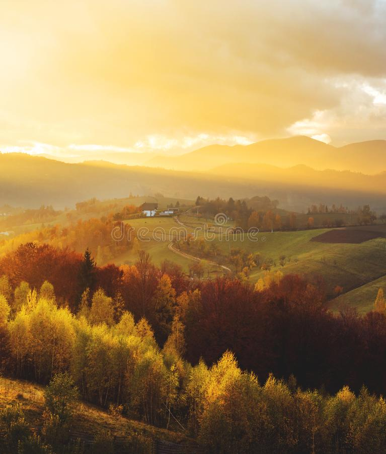 Free Warm October Evening In Transylvania. Magic Autumn Sunset Light Over The Colored Hills Royalty Free Stock Photos - 130156198