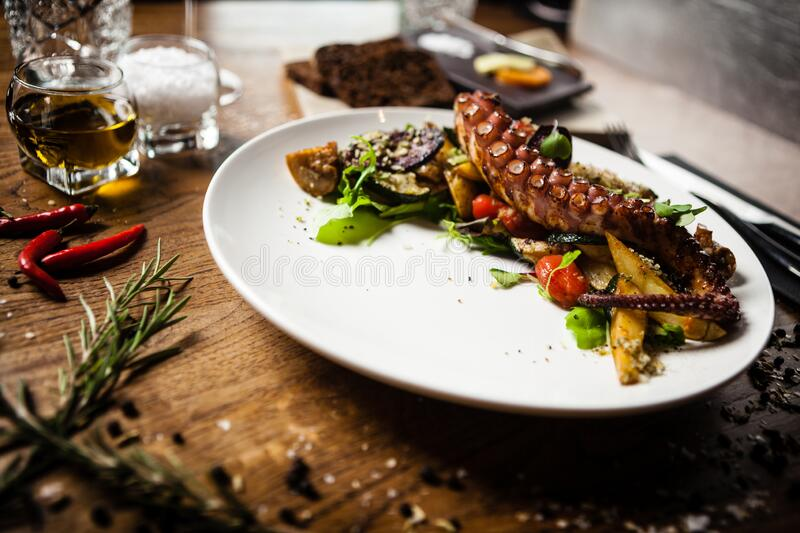 Octopus salad served on a plate in restaurant royalty free stock photo