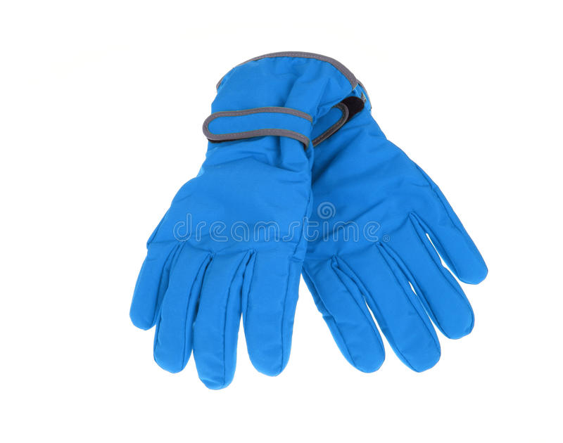 Warm pair of winter blue ski gloves. On an isolated white background royalty free stock photography