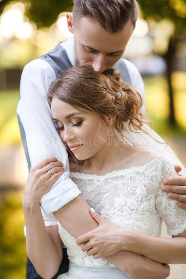 Warm portrait of the bride and groom stock photography