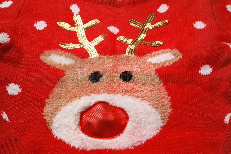 Warm red Christmas sweater with deer as , closeup view. Warm red Christmas sweater with deer as background, closeup view royalty free stock photos