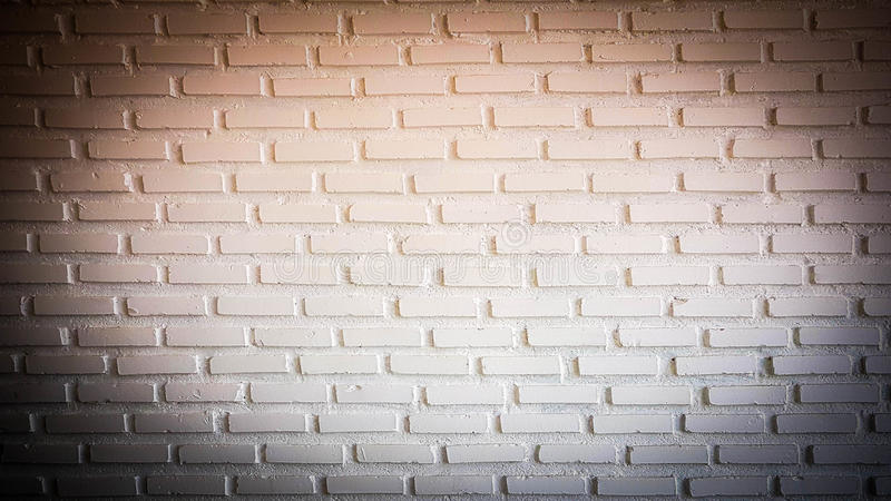 Download Warm Red Spotlight On Brick Wall With Dark Corner Stock Photo