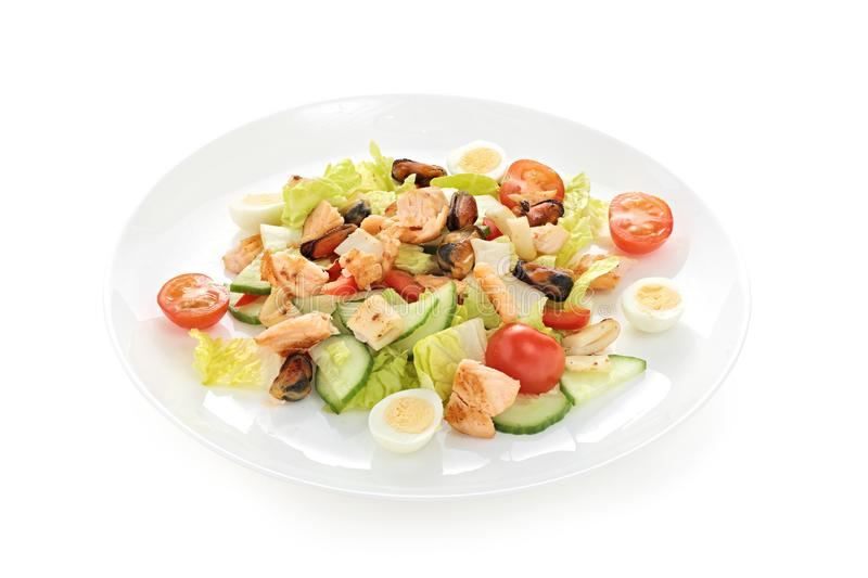 Warm salad sea breeze with tomato cherry squid mussels roasted salmon quail eggs on a white background stock images