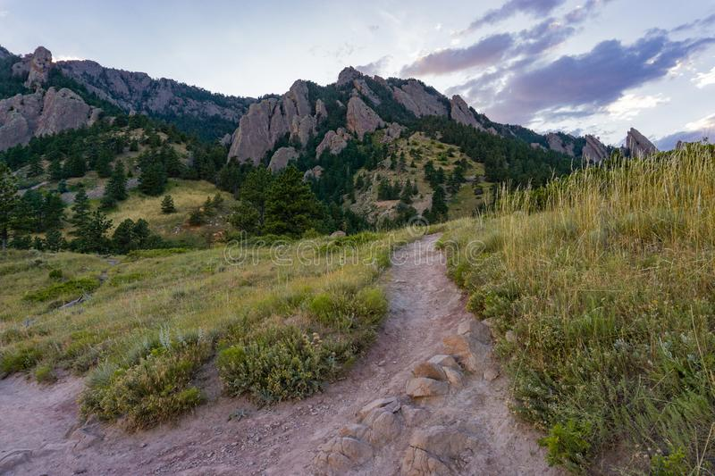 Warm summer sunset over hiking trail in Boulder Colorado. Warm summer sunset in the flatirons in Boulder Colorado stock photography