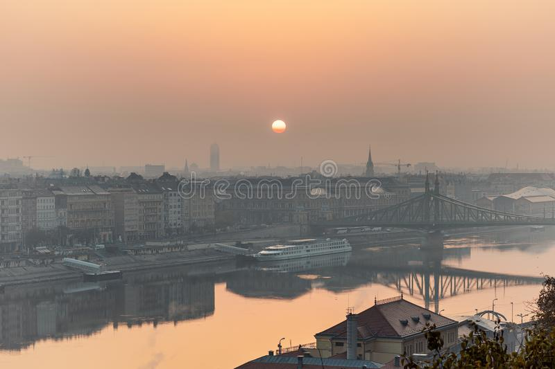 Warm sunrise image of Budapest with a Liberty bridge view. And reflections in Danube river stock image