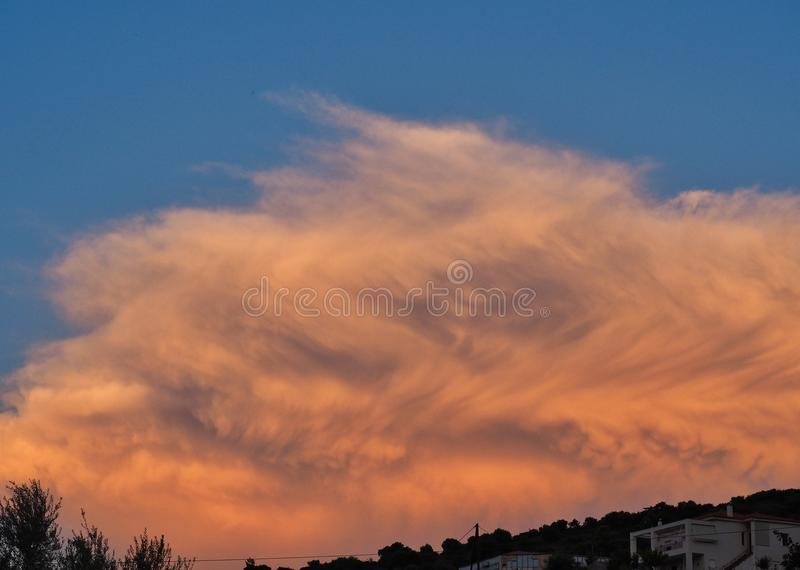 Warm Sunrise Light on Fluffy Clouds royalty free stock photography
