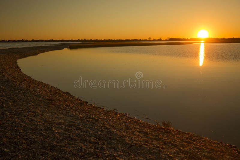 Warm sunset over the marsh at Milford Point, Connecticut. Golden sunset over the marsh at the Milford Point Coastal Center of the Connecticut Audubon Society royalty free stock image