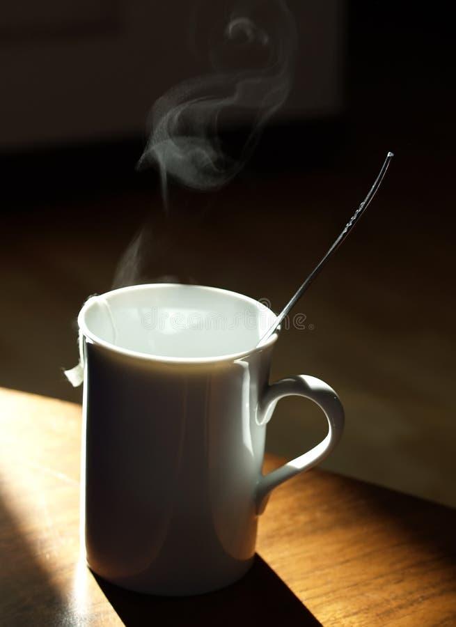 Warm tea mug. Over timber table stock images