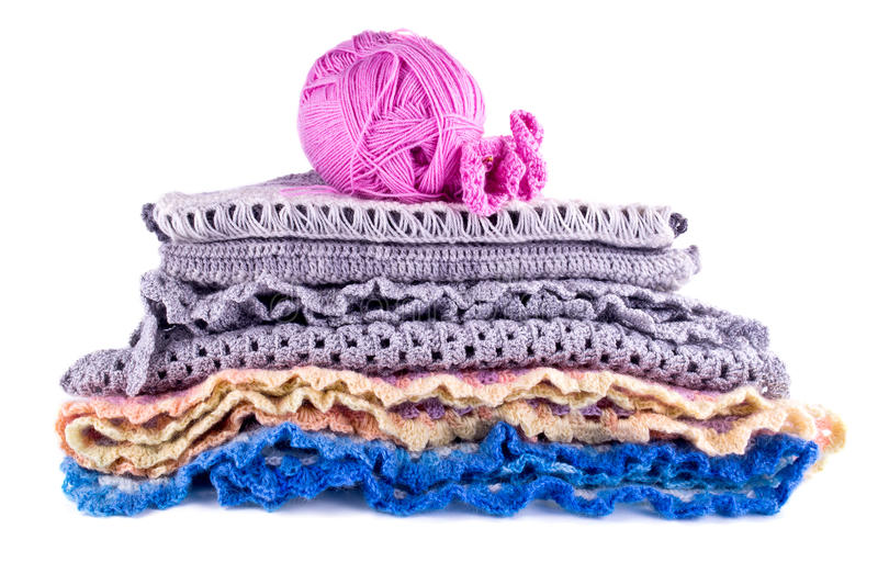 Warm things. Knitted women's warm clothes isolated on white background royalty free stock photography