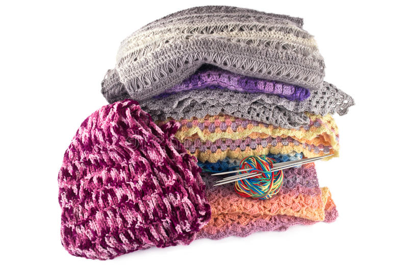 Warm things. Knitted women's warm clothes isolated on white background stock photography