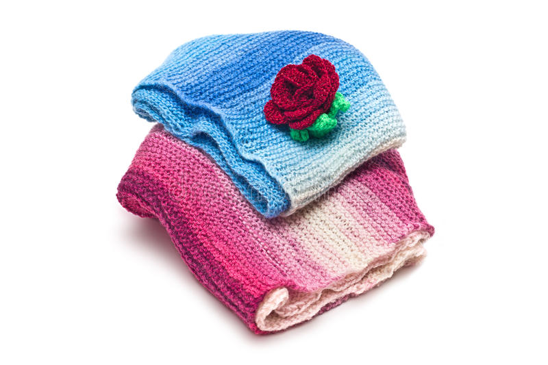 Warm things. Knitted women's warm clothes on white background stock image