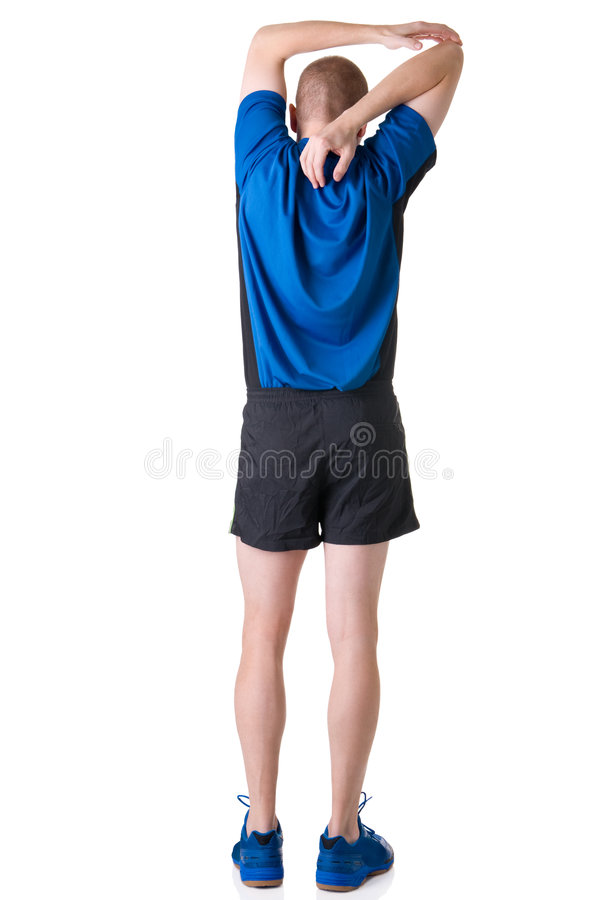 Warm up. Full isolated picture of a caucasian man stretching the muscles royalty free stock image