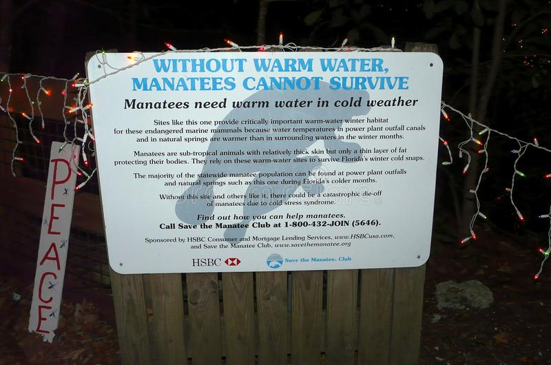 Warm Water Habitat for Manatees Sign. HOMOSASSA, FLORIDA-DECEMBER 21, 2016: At the Celebration of Lights at the Homosassa Springs Wildlife State Park, a sign stock photo