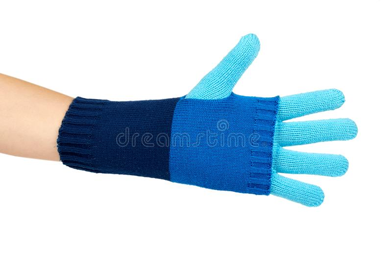 Warm winter children`s gloves in hand isolated on white background. Sale and buy royalty free stock photography