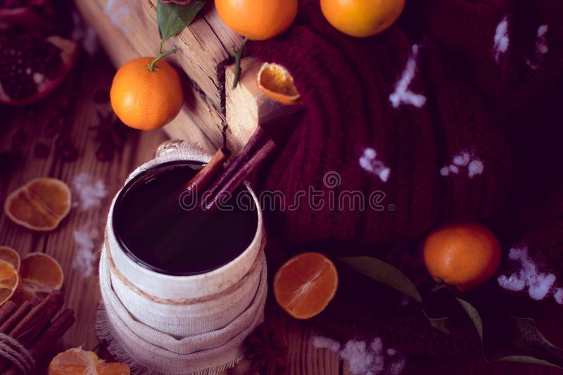 Warm winter with tea and tangerines. Warm winter mug of tea and tangerines. Christmas still life stock photography
